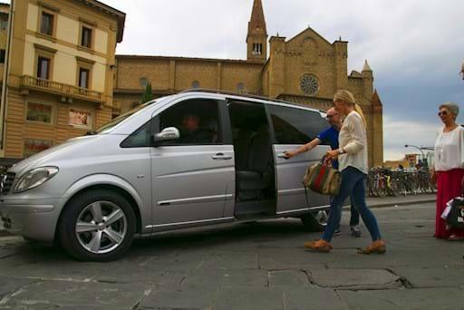people entering luxury car