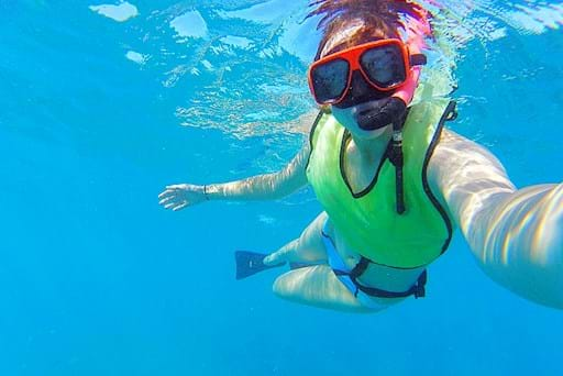 Girl getting a selfie while snorkeling