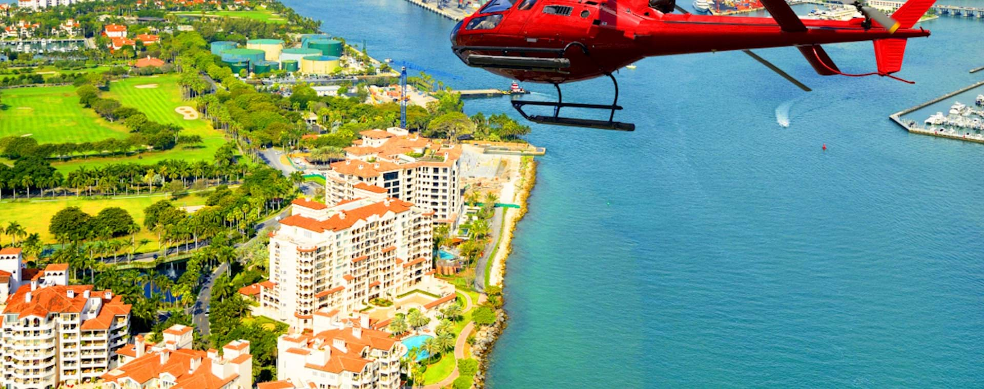 Red Helicopter flying over Miami