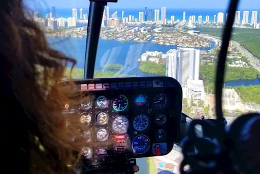 Pilot driving helicopter over Miami