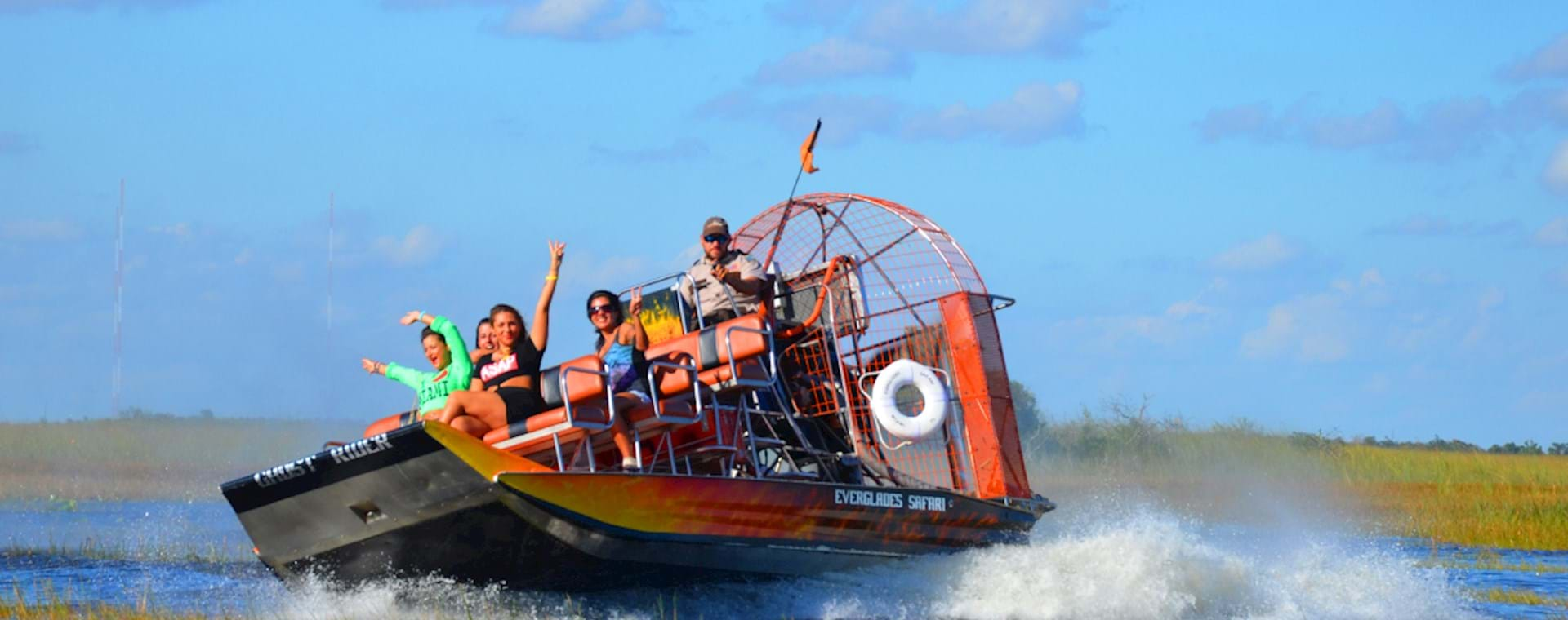People having fun during an airboat ride