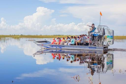 People on an airboat in Everglades, Florida