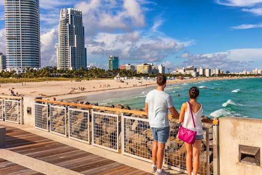 couple walking in South Beach Miami