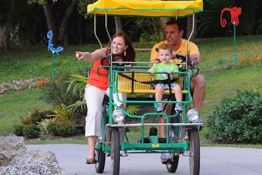 Family biking around the Miami Zoo