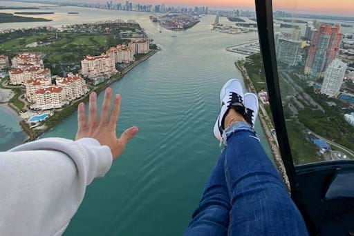 girl feeling the breeze on a helicopter