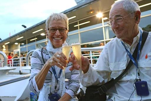 Couple of tourists enjoying a glass of Champagne on a Seine River Cruise Tour