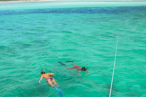 Tourists doing snorkeling in the crystal clear waters of Key West